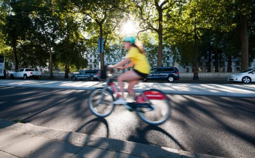 A cyclist on a Santander bike in motion on a Superhighway