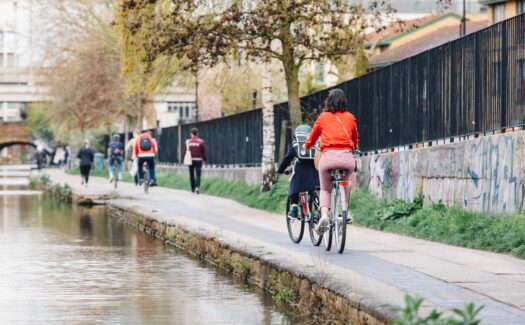 Cyclists riding along the canal
